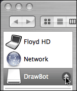Mouse cursor hovering over eject button in background window, while Finder is active.