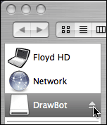 Mouse cursor hovering over eject button in background window, while Finder is also in background.
