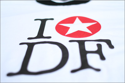 Close-up of 'I [star] DF' t-shirt.