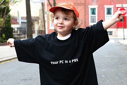 The boy wearing a 'Your PC is a POS' t-shirt