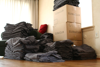 Pile of folded Daring Fireball t-shirts.