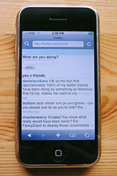 An iPhone displaying the m.twitter.com tweet list.