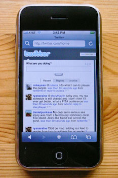 An iPhone displaying Twitter.com zoomed in to the width of the tweets column.