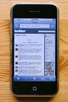 An iPhone displaying Twitter.com at default zooming scale.