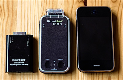 The two Richard Solo backup batteries, side-by-side with an iPhone 3G.