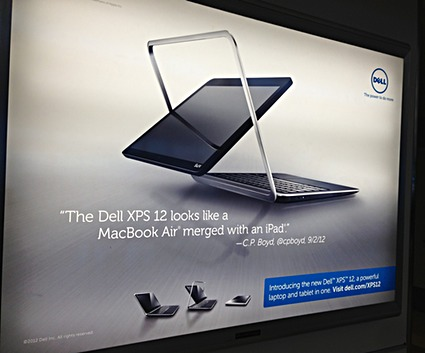 "Photo of an airport terminal billboard from Dell for the XPS 12, a hybrid laptop/tablet. Ad slogan: ""The Dell XPS 12 looks like a MacBook Air merged with an iPad."""