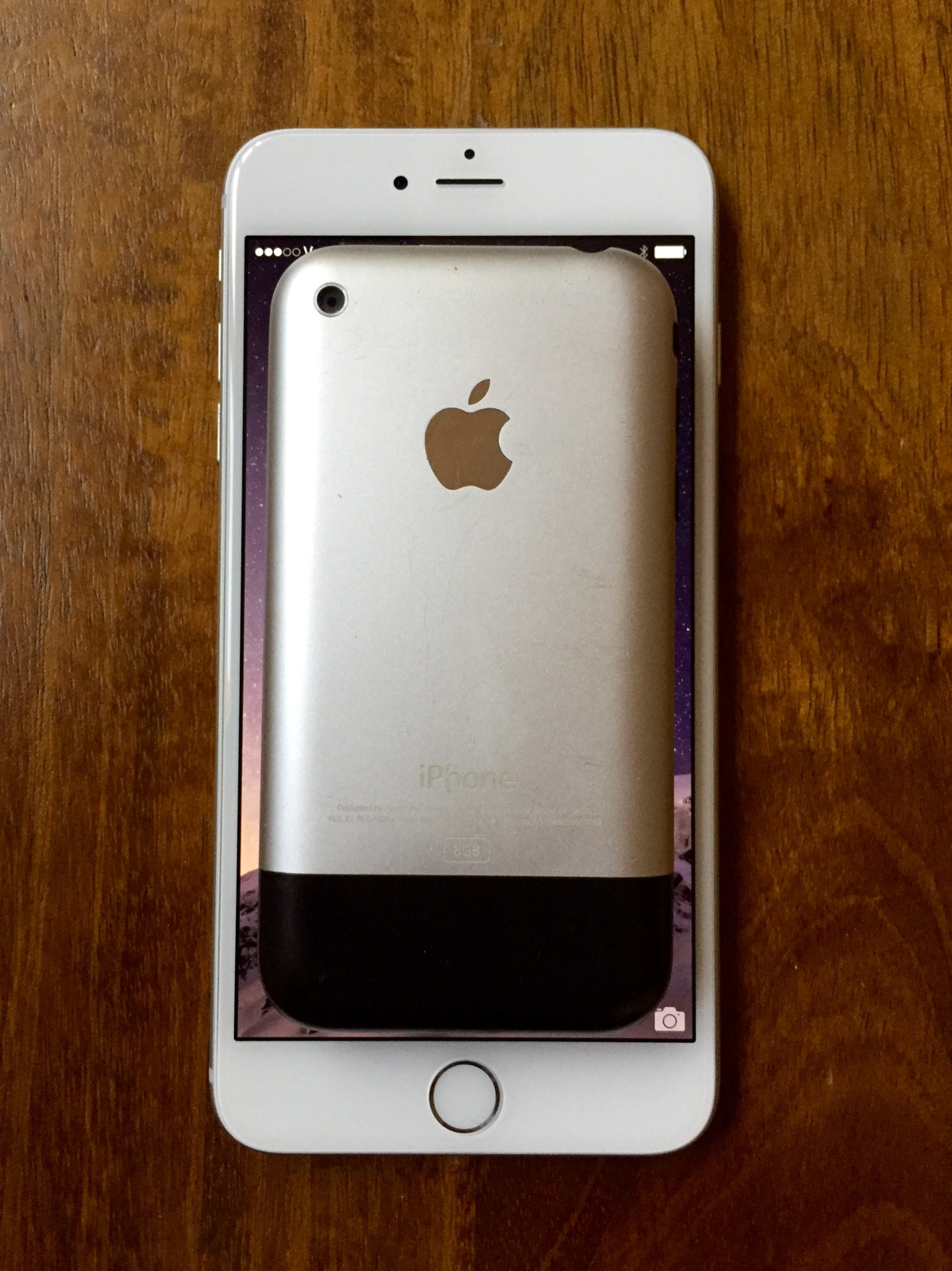 An original 2007 iPhone fits entirely within the display, just the display, of an iPhone 6 Plus.