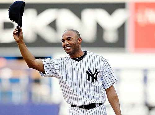 Mariano Rivera tips his cap to the fans after recording his record-breaking 602nd regular season save.
